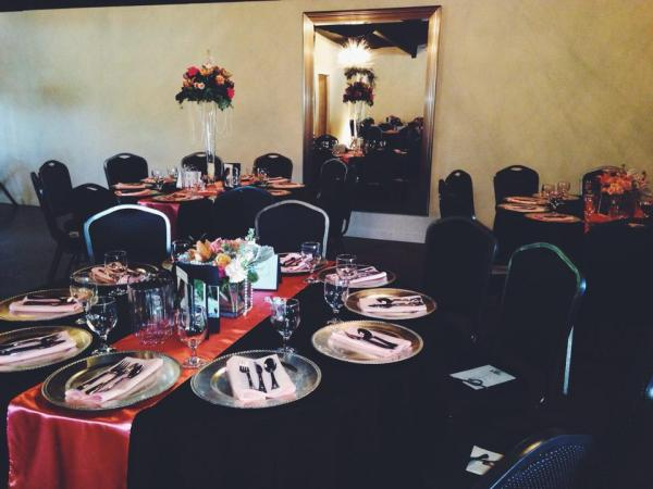 Black and coral linen with our silver chargers and  floral designs by Southern Floral Traditions