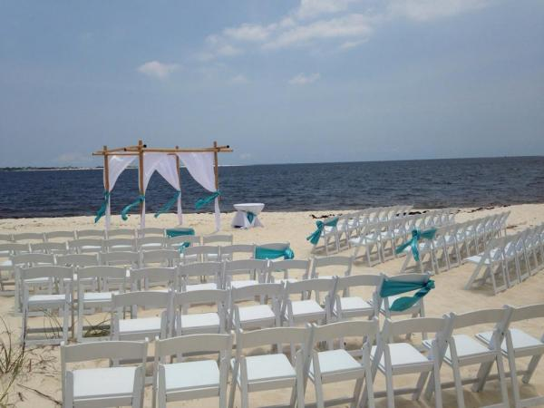 Beach Wedding Bamboo Arbor With Garden Chairs On Pensacola