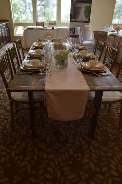 We have wooden farm tables for your event!