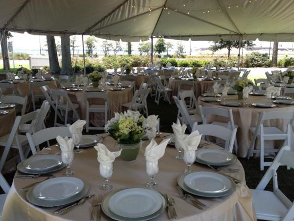 Barkley House Garden Wedding Champagne Overlays, White Garden Chairs,  Silver Chargers.